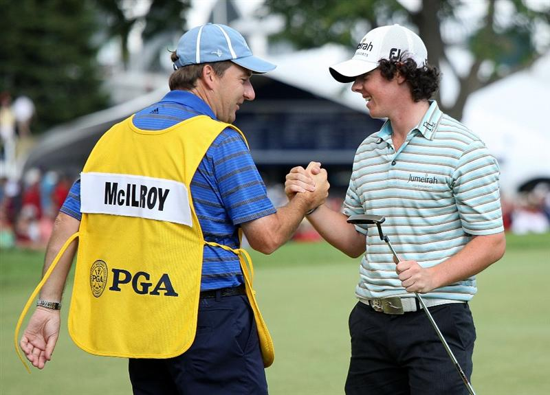 CHASKA, MN - AUGUST 16:  Rory McIlroy of Northern Ireland and caddie JP Fitzgerald shake hands on the 18th green during the final round of the 91st PGA Championship at Hazeltine National Golf Club on August 16, 2009 in Chaska, Minnesota.  (Photo by David Cannon/Getty Images)