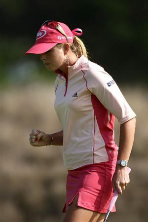 HALF MOON BAY, CA - OCTOBER 05:  Paula Creamer pumps her fist after making a birdie putt on the 2nd hole during the final round of the Samsung World Championship at the Half Moon Bay Golf Links Ocean Course on October 5, 2008 in Half Moon Bay, California.  (Photo by Jonathan Ferrey/Getty Images)