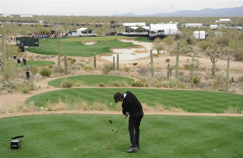 MARANA, AZ - FEBRUARY 26:  Bubba Watson plays his tee shot on the 12th hole during the semifinal round of the Accenture Match Play Championship at the Ritz-Carlton Golf Club on February 26, 2011 in Marana, Arizona.  (Photo by Stuart Franklin/Getty Images)