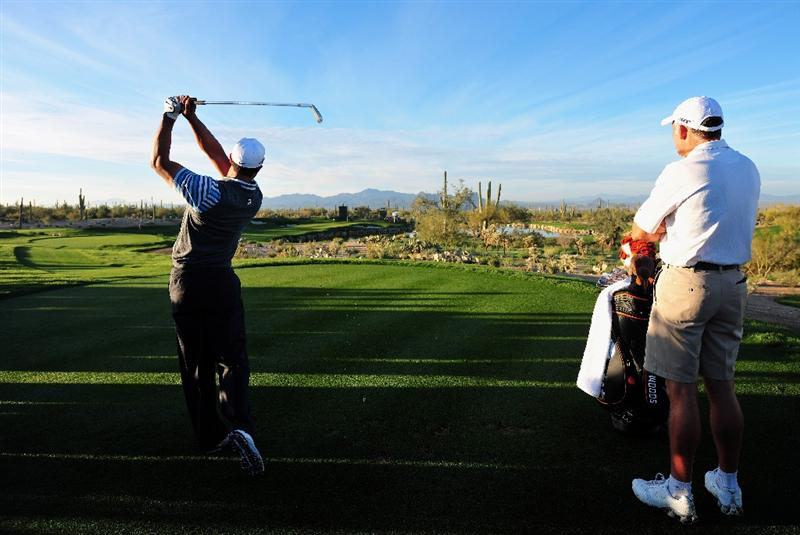 MARANA, AZ - FEBRUARY 24:  Tiger Woods of the USA plays his tee shot watched by caddie Steve Williams during practice prior to the start of the Accenture Match Play Championships at Ritz - Carlton Golf Club at Dove Mountain on February 24, 2009 in Marana, Arizona.  (Photo by Stuart Franklin/Getty Images)