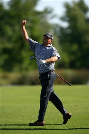 AVONDALE, LA - APRIL 25:  Jason Bohn punches the air following his approach shot to the 18th green during the final round of the Zurich Classic at TPC Louisiana on April 25, 2010 in Avondale, Louisiana.  (Photo by Chris Trotman/Getty Images)