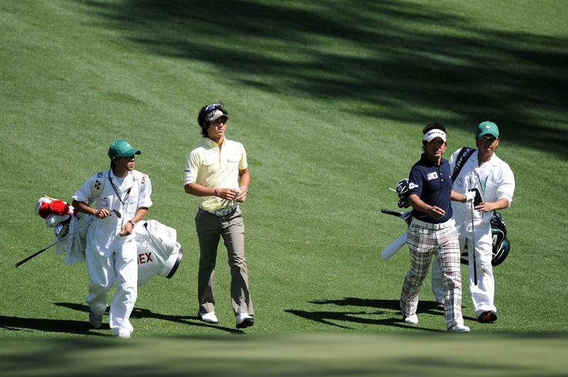 AUGUSTA, GA - APRIL 04:  Hiroyuki Fujita (R) and Ryo Ishikawa of Japan walk with their caddies during a practice round prior to the 2011 Masters Tournament at Augusta National Golf Club on April 4, 2011 in Augusta, Georgia.  (Photo by Harry How/Getty Images)