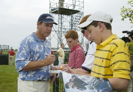Leader Tom Purtzer signs an autograph for fans after the first round of the 2005 Liberty Mutual Legends of Golf tournament at the Westin Savannah Harbor Golf Resort & Spa on April 22, 2005 in Savannah, Georgia.Photo by Al Messerschmidt/WireImage.com