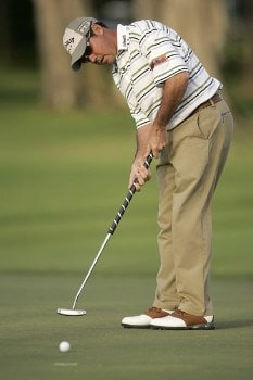 Rich Beem putts on the 11th gree during the first round of the PGA TOUR's Sony Open, January 12, 2006 at the Waialae Country Club in Honolulu, Hawaii.Photo by M. Garcia/WireImage.com