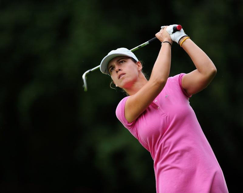 EVIAN-LES-BAINS, FRANCE - JULY 24:  Karine Icher of France plays her approach shot on the 14th hole during the second round of the Evian Masters at the Evian Masters Golf Club on July 24, 2009 in Evian-les-Bains, France.  (Photo by Stuart Franklin/Getty Images)