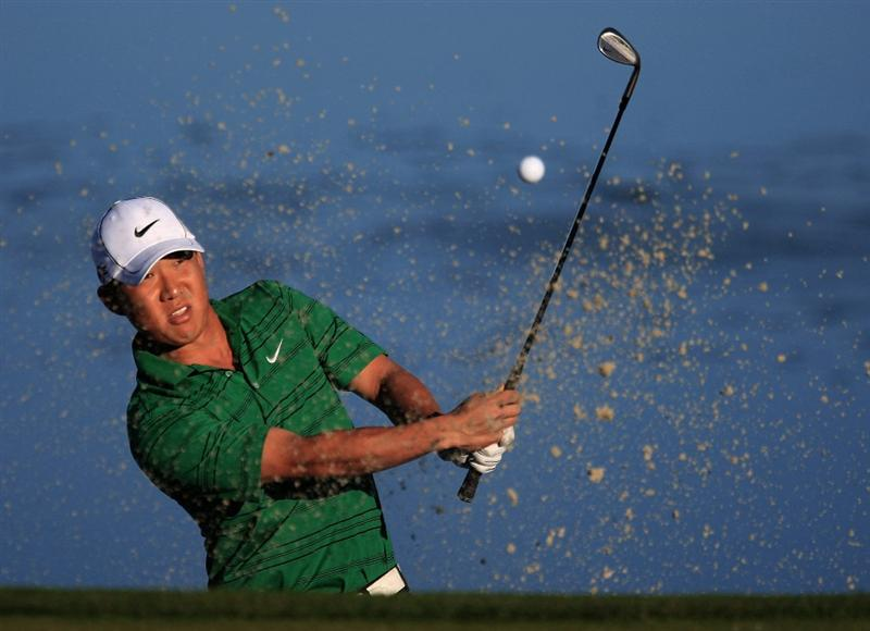 MARANA, AZ - FEBRUARY 25:  Anthony Kim hits a bunker shot on the third hole during the first round of the Accenture Match Play Championship at the Ritz-Carlton Golf Club at Dove Mountain on February 25, 2009 in Marana, Arizona.  (Photo by Scott Halleran/Getty Images)