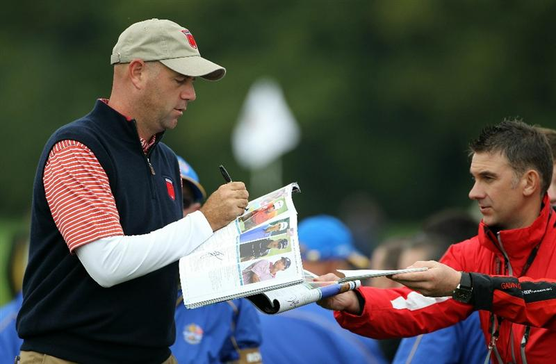 NEWPORT, WALES - SEPTEMBER 30:  Stewart Cink of the USA signs an autograph during a practice round prior to the 2010 Ryder Cup at the Celtic Manor Resort on September 30, 2010 in Newport, Wales. (Photo by Jamie Squire/Getty Images)
