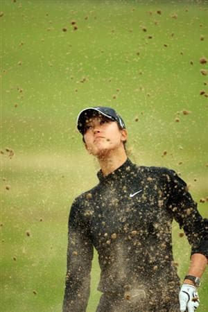 LYTHAM ST ANNES, ENGLAND - JULY 29:  Michelle Wie of the USA plays out of a bunker during practice prior to the 2009 Ricoh Women's British Open Championship held at Royal Lytham St Annes Golf Club, on July 29, 2009 in Lytham St Annes, England.  (Photo by Warren Little/Getty Images)