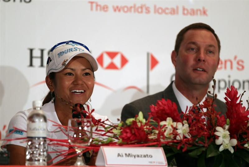 SINGAPORE - FEBRUARY 22:  Ai Miyazato of Japan and Mike Whan, the LPGA Commissioner during a photocall at the Fairmont Hotel prior to the HSBC Women's Champions at Tanah Merah Country Club  on February 22, 2011 in Singapore, Singapore.  (Photo by Ross Kinnaird/Getty Images)
