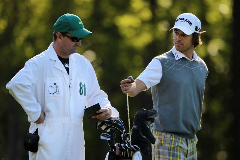 AUGUSTA, GA - APRIL 06:  Aaron Baddeley of Australia pulls a club alongside caddie Anthony Knight during a practice round prior to the 2011 Masters Tournament at Augusta National Golf Club on April 6, 2011 in Augusta, Georgia.  (Photo by Jamie Squire/Getty Images)