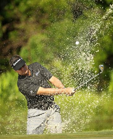 LUTZ, FL - APRIL 15:  Kenny Perry hits out of a bunker on the 13th hole dring the first round of the Outback Steakhouse Pro-Am at TPC Tampa Bay on April 15, 2011 in Lutz, Florida.  (Photo by Mike Ehrmann/Getty Images)