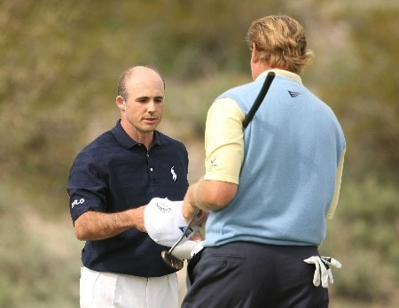 MARANA, AZ - FEBRUARY 20:  Jonathan Byrd (L) shakes hands with Ernie Els of South Africa after defeating him 6 and 5 during the first round matches of the WGC-Accenture Match Play Championship at The Gallery at Dove Mountain on February 20, 2008 in Marana, Arizona.  (Photo by Scott Halleran/Getty Images)