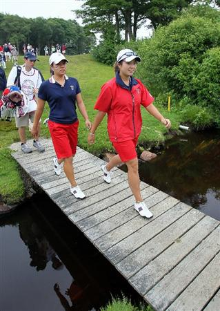 MANCHESTER, MA - JUNE 12: Stephanie Kono (L) and Kimberly Kim of the United States head for the seventh green during Four Ball competition on the second day of the 2010 Curtis Cup Match at the Essex Country Club on June 12, 2010 in Manchester, Massachusetts. (Photo by Jim Rogash/Getty Images)
