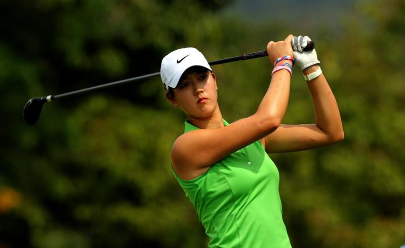 KUALA LUMPUR, MALAYSIA -OCTOBER 21: Michelle Wie of USA plays her 2nd shot on the 5th hole during the Sime Darby Pro-Am at the KLGCC Golf Course on October 21, 2010 in Kuala Lumpur, Malaysia.  (Photo by Stanley Chou/Getty Images)