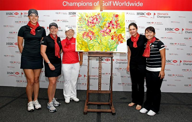 SINGAPORE - FEBRUARY 23:  (L-R) Michelle Wie of the USA, Christie Kerr of the USA, Jiyai Shin of South Korea, Lorena Ochoa of Mexico and Ai Miyazato of Japan pose next to the batik artwork they all contributed to during a photocall at Raffles Hotel prior to the HSBC Women's Champions at the Tanah Merah Country Club  on February 23, 2010 in Singapore.  (Photo by Andrew Redington/Getty Images)