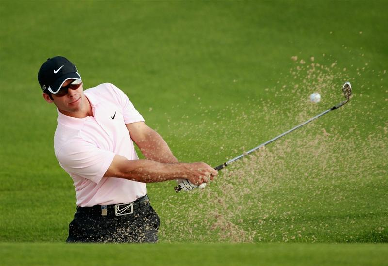 BAHRAIN, BAHRAIN - JANUARY 30:  Paul Casey of England plays a bunker shot on the 13th hole during the final round of the Volvo Golf Champions at The Royal Golf Club on January 30, 2011 in Bahrain, Bahrain.  (Photo by Andrew Redington/Getty Images)