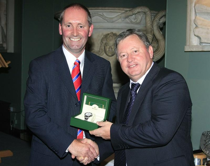 WOBURN, ENGLAND - SEPTEMBER 04:  Ian Woosnam of Wales receives from Andy Stubbs, the Rolex Player of the Year Award at the Annual Awards Dinner held at Woburn Abbey prior to the first round of the Travis Perkins plc Senior Masters played at The Duke's Course, Woburn Golf Club on September 3, 2009 in Woburn, United Kingdom  (Photo by Phil Inglis/Getty Images)