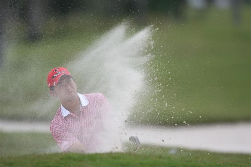 DORAL, FL - MARCH 11:  Yuta Ikeda of Japan hits out of the bunker on the 11th hole during round one of the 2010 WGC-CA Championship at the TPC Blue Monster at Doral on March 11, 2010 in Doral, Florida.  (Photo by Marc Serota/Getty Images)