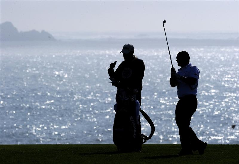 PEBBLE BEACH, CA - FEBRUARY 13:  Alex Cejka of Germany plays his approach shot on the eighth hole during third round of the AT&T Pebble Beach National Pro-Am at Pebble Beach Golf Links on February 13, 2010 in Pebble Beach, California.  (Photo by Stuart Franklin/Getty Images)