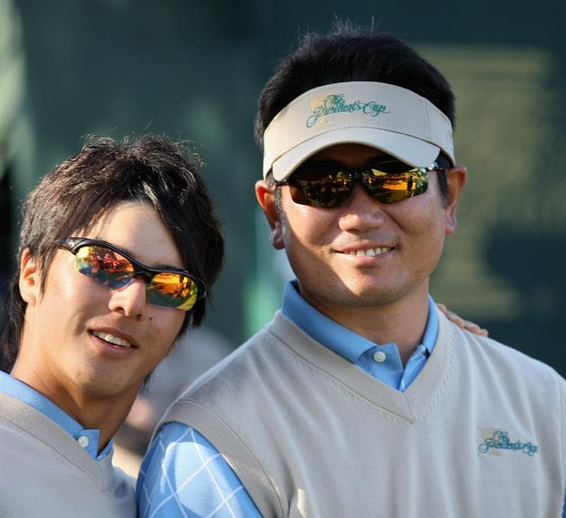 SAN FRANCISCO - OCTOBER 09: Ryo Ishikawa and Y.E. Yang of the International Team pose for a picture after Day Two Fourball Matches of The Presidents Cup at Harding Park Golf Course on October 9, 2009 in San Francisco, California.  (Photo by Warren Little/Getty Images)