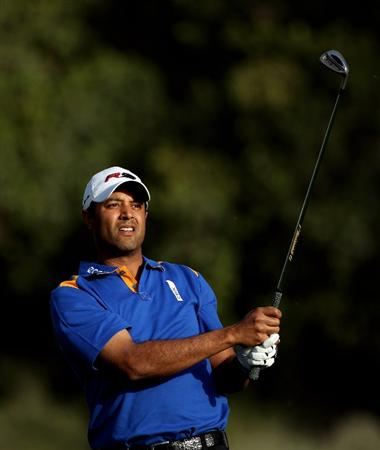 DUBAI, UNITED ARAB EMIRATES - FEBRUARY 04:  Arjun Atwal of India plays his third shot on the third hole during the first round of the Omega Dubai Desert Classic on February 4, 2010 in Dubai, United Arab Emirates.  (Photo by Andrew Redington/Getty Images)