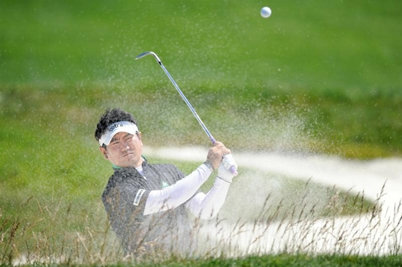 PEBBLE BEACH, CA - JUNE 16:  Y.E. Yang of South Korea plays from a bunker during a practice round prior to the start of the 110th U.S. Open at Pebble Beach Golf Links on June 16, 2010 in Pebble Beach, California.  (Photo by Harry How/Getty Images)