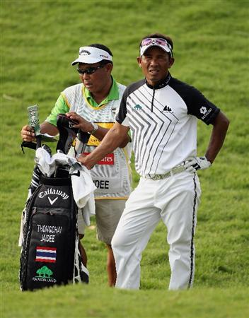 KUALA LUMPUR, MALAYSIA - MARCH 06:  Thongchai Jaidee of Thailand waits with his caddie on the 18th hole during the the third round of the Maybank Malaysian Open at the Kuala Lumpur Golf and Country Club on March 6, 2010 in Kuala Lumpur, Malaysia.  (Photo by Andrew Redington/Getty Images)