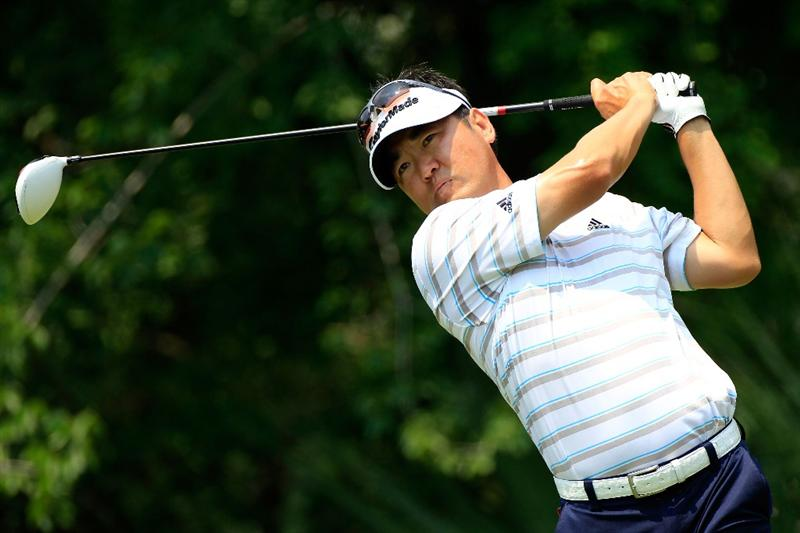 PONTE VEDRA BEACH, FL - MAY 14:  Charlie Wi of South Korea hits his tee shot on the fifth hole during the third round of THE PLAYERS Championship held at THE PLAYERS Stadium course at TPC Sawgrass on May 14, 2011 in Ponte Vedra Beach, Florida.  (Photo by Sam Greenwood/Getty Images)