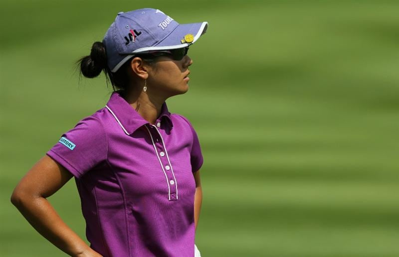 KUALA LUMPUR, MALAYSIA - OCTOBER 22 : Al Miyazato of Japan watches her 2nd shot on the 1st hole of Korea Republic during Round One of the Sime Darby LPGA on October 22, 2010 at the Kuala Lumpur Golf and Country Club in Kuala Lumpur, Malaysia. (Photo by Stanley Chou/Getty Images)