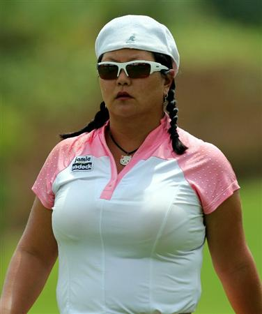 KUALA LUMPUR, MALAYSIA - OCTOBER 23 : Cristina Kim of USA walks to the 4th hole during Round Two of the Sime Darby LPGA on October 23, 2010 at the Kuala Lumpur Golf and Country Club in Kuala Lumpur, Malaysia. (Photo by Stanley Chou/Getty Images)