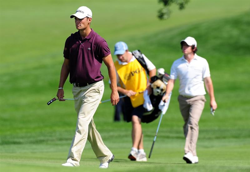 CHASKA, MN - AUGUST 14:  Martin Kaymer of Germany (L) walks alongside Rory McIlroy of Northern Ireland (R) up the ninth fairway during the second round of the 91st PGA Championship at Hazeltine National Golf Club on August 14, 2009 in Chaska, Minnesota.  (Photo by Stuart Franklin/Getty Images)