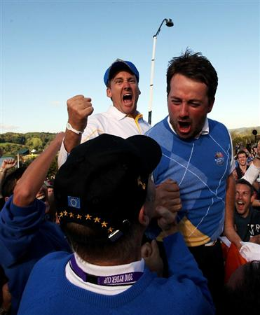 NEWPORT, WALES - OCTOBER 04:  Graeme McDowell (R) and Ian Poulter of Europe celebrates the victory for the European team at the end of the singles matches during the 2010 Ryder Cup at the Celtic Manor Resort on October 4, 2010 in Newport, Wales.  (Photo by Jamie Squire/Getty Images)
