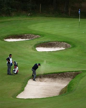 DUMBARTON, SCOTLAND - SEPTEMBER 18: Mark Sheftic of the USA plays out the bunker on the 13th green in the afternoon four ball matches at The Carrick on Loch Lomond on September 18, 2009 in Dumbarton, Scotland.  (Photo by Jeff J Mitchell/Getty Images)