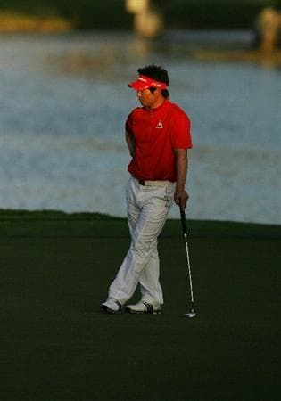 PALM BEACH GARDENS, FL - MARCH 07:  Y.E. Yang waits to putt on the 18th hole during the third round of The Honda Classic at PGA National Resort and Spa on March 7, 2009 in Palm Beach Gardens, Florida.  (Photo by Doug Benc/Getty Images)
