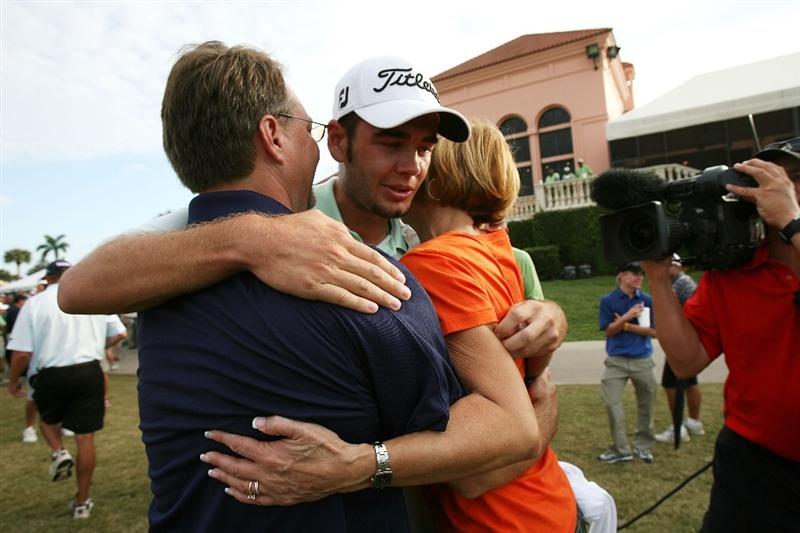 WEST PALM BEACH, FL - DECEMBER 07:  Troy Merritt hugs family and freinds after winning medalist honors during the final round of the 2009 PGA TOUR Qualifying Tournament at Bear Lakes Country Club on December 7, 2009 in West Palm Beach, Florida.  (Photo by Doug Benc/Getty Images)