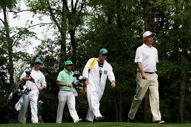 AUGUSTA, GA - APRIL 09:  Fred Couples (R) and Rickie Fowler walk off the second tee with their caddies during the third round of the 2011 Masters Tournament at Augusta National Golf Club on April 9, 2011 in Augusta, Georgia.  (Photo by David Cannon/Getty Images)