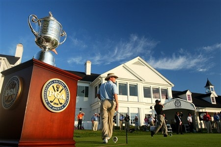 BLOOMFIELD HILLS, MI - AUGUST 07:  The trophy is seen next to Bradley Dean who is playing the first tee shot of the day in front of the clubhouse during round one of the 90th PGA Championship at Oakland Hills Country Club on August 7, 2008 in Bloomfield Township, Michigan.  (Photo by Stuart Franklin/Getty Images)