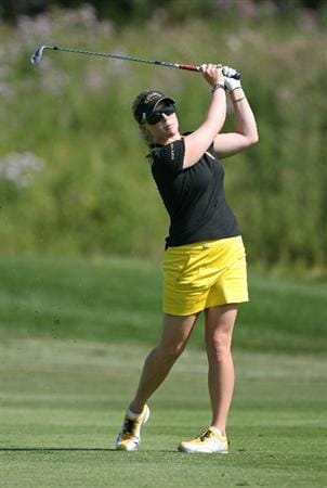 CALGARY, AB - SEPTEMBER 03: Morgan Pressel of the United States hits her third shot on the ninth hole during the first round of the Canadian Women's Open at Priddis Greens Golf & Country Club on September 3, 2009 in Calgary, Alberta, Canada. (Photo by Hunter Martin/Getty Images)
