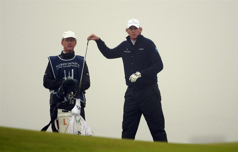 KINGSBARNS, SCOTLAND - OCTOBER 08:  Maarten Lafeber of The Netherlands waits with his caddie on the ninth hole during the second round of The Alfred Dunhill Links Championship at Kingsbarns Golf Links on October 8, 2010 in Kingsbarns, Scotland.  (Photo by Andrew Redington/Getty Images)