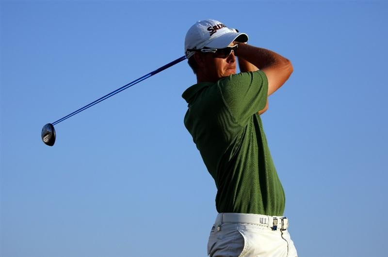 DUBAI, UNITED ARAB EMIRATES - JANUARY 31:  Henrik Stenson of Sweden tees off on the eighth hole during the third round of the Dubai Desert Classic on the Majilis course at Emirates Golf Club on January 31, 2009 in Dubai, United Arab Emirates.  (Photo by Andrew Redington/Getty Images)