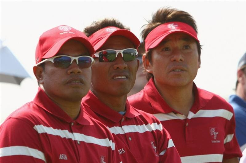 BANGKOK, THAILAND - JANUARY 09:  (R to L)Asian Team Captain Naomochi ?Joe? Ozak, Thongchai Jaidee of Thailand and Prayad Marksaeng look on during Day one of The Royal Trophy at the Amata Spring Country Club on January 8, 2009 in Bangkok, Thailand.  (Photo by Ian Walton/Getty Images)