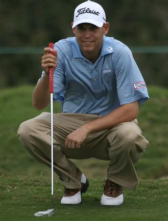 DORAL, FL - MARCH 12:  Bill Haas lines up a shot on the fifth hole during round two of the 2010 WGC-CA Championship at the TPC Blue Monster at Doral on March 12, 2010 in Doral, Florida.  (Photo by Marc Serota/Getty Images)