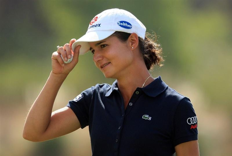 HUIXQUILUCAN, MEXICO - MARCH 21:  Lorena Ochoa of Mexico smiles as she walks off the ninth green during the second round of the MasterCard Classic at the BosqueReal Country Club on March 21, 2009 in Huixquiucan, Mexico.  (Photo by Scott Halleran/Getty Images)