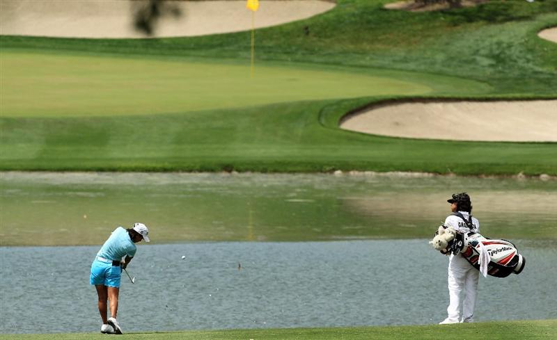 RANCHO MIRAGE, CA - APRIL 02:  Julieta Granada of Paraguay plays her second shot at the par 4, 6th hole during the third round of the 2011 Kraft Nabisco Championship on the Dinah Shore Championship Course at the Mission Hills Country Club on April 2, 2011 in Rancho Mirage, California.  (Photo by David Cannon/Getty Images)