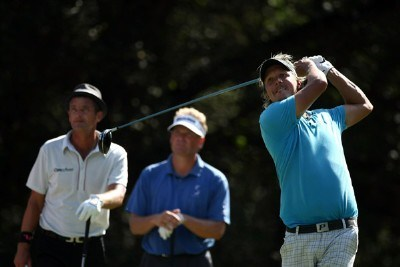 Fredrik Jacobson tees off on the 15th hole while Mathias Gronberg and Jesper Parnevik watch during the third round of the Valero Texas Open at La Cantera Golf Club October 6, 2007 in San Antonio, Texas. PGA TOUR - 2007 Valero Texas Open - Third RoundPhoto by Jonathan Ferrey/WireImage.com