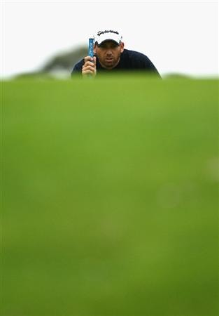 MELBOURNE, AUSTRALIA - NOVEMBER 13:  Sergio Garcia of Spain lines up a putt during round three of the Australian Masters at The Victoria Golf Club on November 13, 2010 in Melbourne, Australia.  (Photo by Ryan Pierse/Getty Images)