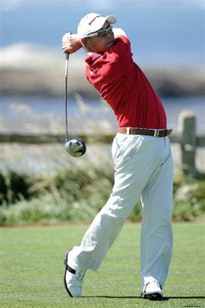 PEBBLE BEACH, CA - JUNE 16:  Toru Taniguchi of Japan hits a shot during a practice round prior to the start of the 110th U.S. Open at Pebble Beach Golf Links on June 16, 2010 in Pebble Beach, California.  (Photo by Harry How/Getty Images)