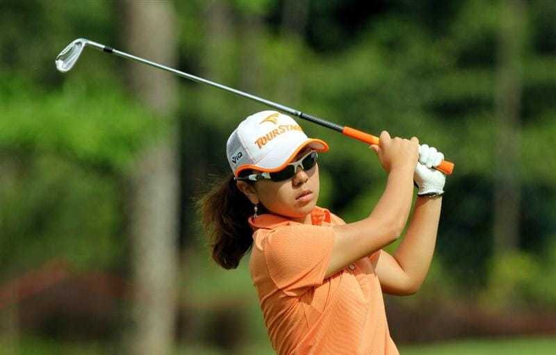 KUALA LUMPUR, MALAYSIA - OCTOBER 24 : Mika Miyazato of Japan watches her 2nd shot on the 1st hole during the Final Round of the Sime Darby LPGA at the Kuala Lumpur Golf and Country Club on October 24, 2010 in Kuala Lumpur, Malaysia. (Photo by Stanley Chou/Getty Images)
