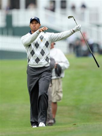 SAN FRANCISCO - OCTOBER 10: Tiger Woods of the USA Team follows his second shot at the par 5, 18th hole during the Day Three Morning Fousomes Matches in The Presidents Cup at Harding Park Golf Course on October 10, 2009 in San Francisco, California  (Photo by David Cannon/Getty Images)