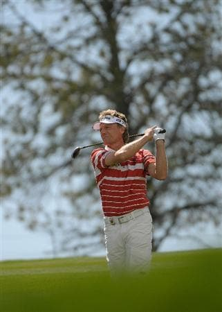 PARKER, CO. - MAY 27:   Bernhard Langer of Germany hits his approach shot to the 15th hole during the first round of the Senior PGA Championship at the Colorado Golf Club  on May 27, 2010 in Parker, Colorado.  (Photo by Marc Feldman/Getty Images)